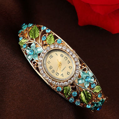 Gifts 4 All, Beautiful watch has floral design. Dial has Crystals all around.